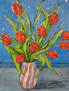 Red Tulips in stripey vase